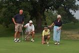 Dave Johnson, Tom Field, Rosemary Johnson, and Candy Field, line up a crucial putt